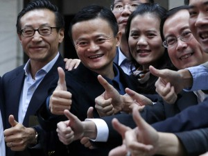 "Alibaba Group Holding Ltd founder Jack Ma (2nd L) poses as he arrives at the New York Stock Exchange for his company's initial public offering (IPO) under the ticker ""BABA"" in New York September 19, 2014"