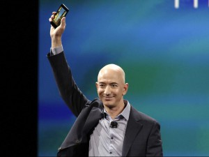 Amazon CEO Jeff Bezos holds the Fire Phone