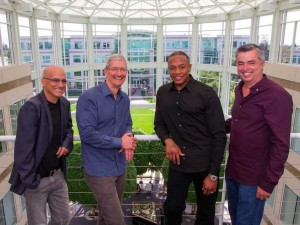 Beats cofounders Jimmy Iovine (left) and Dr. Dre (second from right) pose with Apple CEO TIm Cook and SVP Eddy Cue (right).